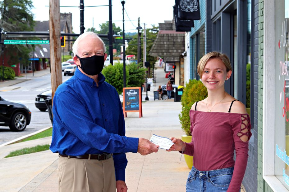 Madison Echols receives check from Tom Buckridge